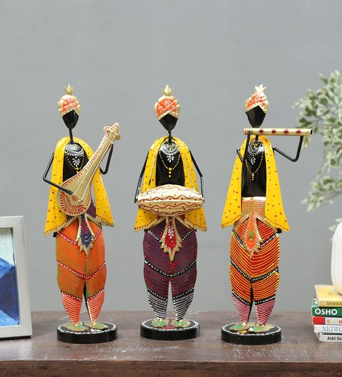 multicolor wrought iron human figurine set of 3 by godeccor multicolor wrought iron human figurine s ynr3i1